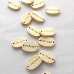 Puinen handmade -kyltti