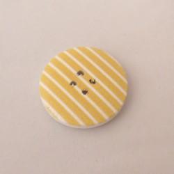 Kelta-valkoraidallinen nappi